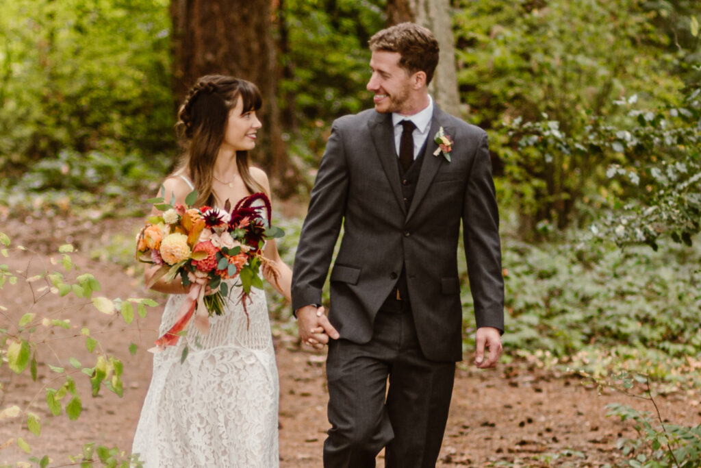 Outshined Photography photographs couple walking through woods in Kitsap Peninsula