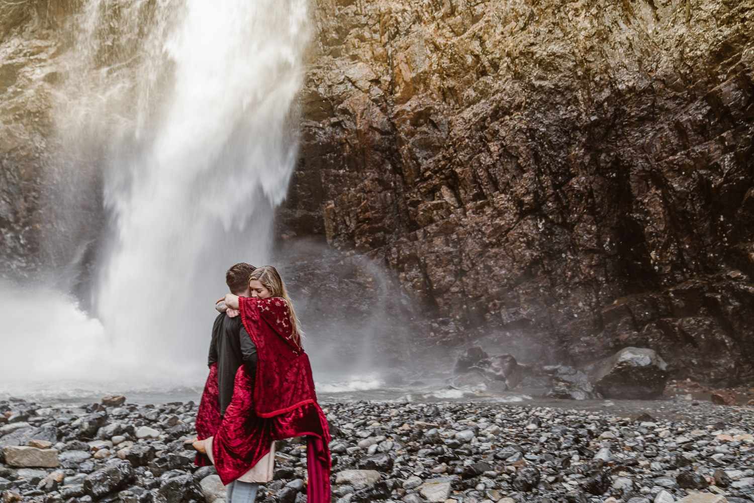 PNW Elopement Photographer, Eloping in nature, Couple celebrates their love for each other at the base of Franklin Falls