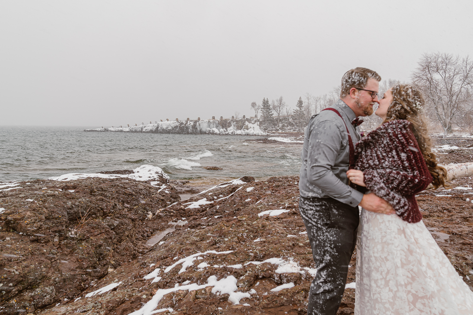 Plan ahead and prepare to be ready for any kind of weather, this couple eloped during a springtime snow storm